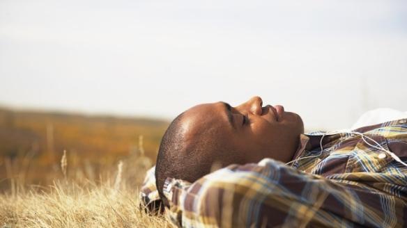 Man resting in field (Small 640x360)